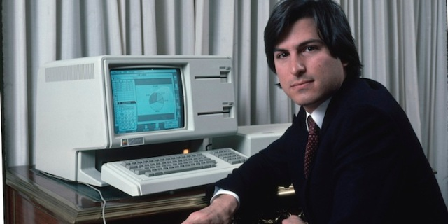 Apple computer Chrmn. Steve Jobs w. new LISA computer during press preview.